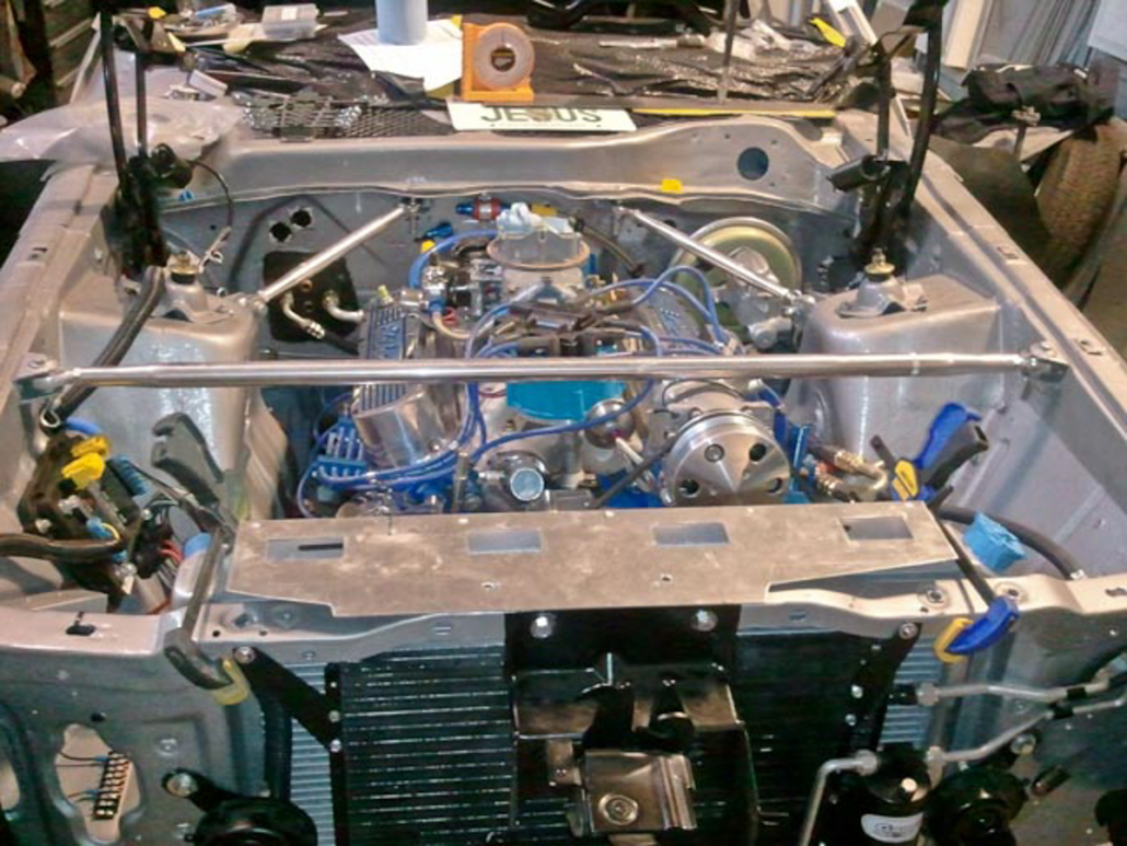 Picture under the hood of a 1971 Mustang wired with the Infinitybox system.