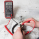 Picture showing how to use a multimeter to check continuity between terminals on a headlight switch