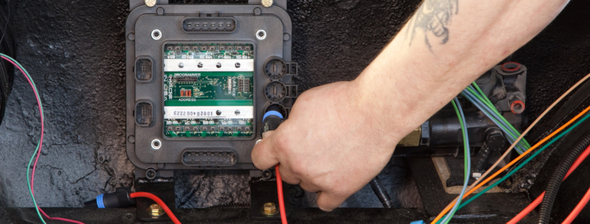 Plugging in POWERCELL battery input harness in Infinitybox system installed in 1967 Mustang